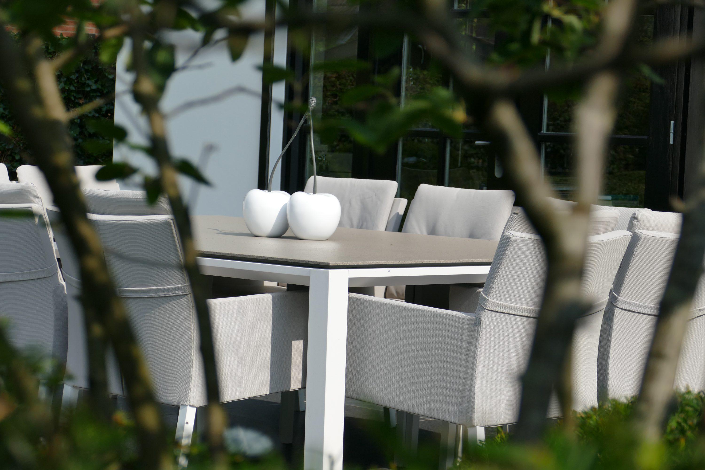 In uw exclusieve tuin met organische vormen is het zomer en winter altijd genieten.